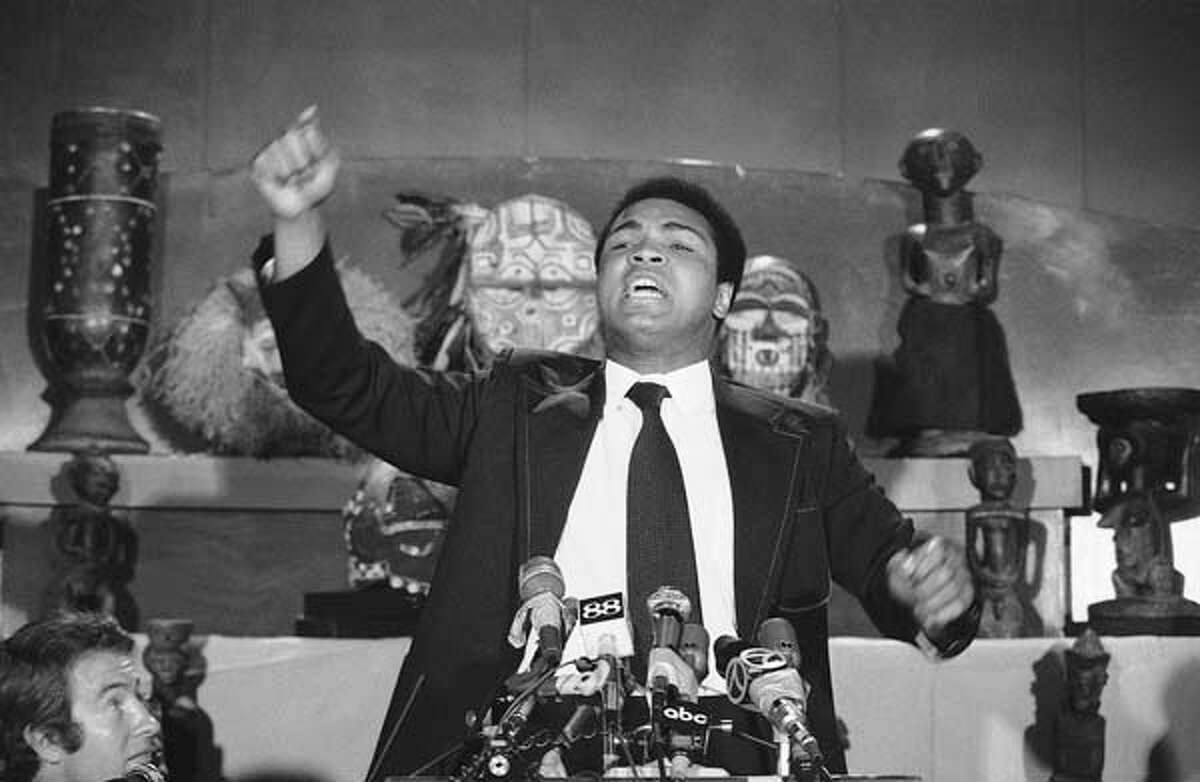 May 15: Former heavyweight champion Muhammad Ali addresses a press conference at a New York City restaurant. Ali chided George Foreman for failing to show up at the conference, called to announce their projected $30 million title bout at Kinshana, Zaire that was originally slated for Sept. 25. Each was guaranteed $5 million for the match.