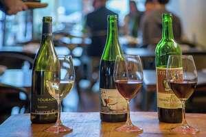 """A wine flight of Francois 2013 Chidane, Sauvignon Touraine; 2013 Domaine du Belair """"Jour de Soif,"""" Bourqueil; and 2009 Heitz Cellar Napa Valley Cabernet Sauvignon at Les Clos in S.F."""