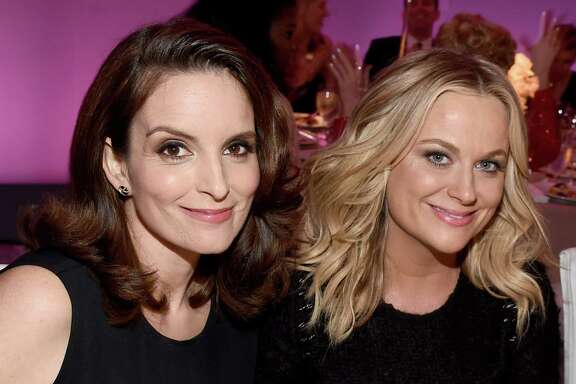 Tina Fey, left, and Amy Poehler will host the Golden Globes for a third and final time in January.