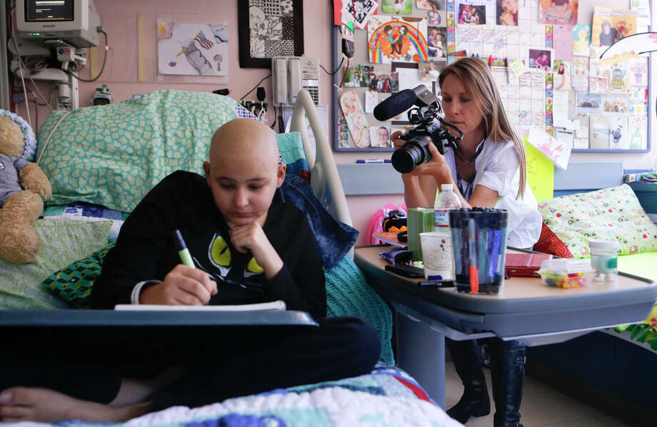 Jade Waters-Tippo, program manager for BayKids Studios, takes video of Emily Marler, 14, who's exploring her creativity while recovering from a bone marrow transplant at UCSF Benioff Children's Hospital San Francisco. Photo: Michael Macor / Michael Macor / The Chronicle / ONLINE_YES