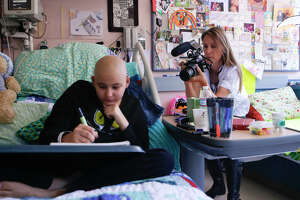 Jade Waters-Tippo, program manager for BayKids Studios, takes video of Emily Marler, 14, who's exploring her creativity while recovering from a bone marrow transplant at UCSF Benioff Children's Hospital San Francisco.