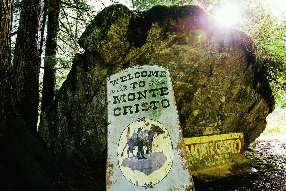 Original signage welcomes visitors to the defunct mining town of Monte Cristo, photographed Monday, Oct. 27, 2014. The town can be accessed via a four-mile hike through the forest, starting at the Barlow Pass Trailhead.