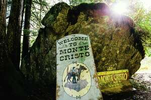 Original signage welcomes visitors to the defunct mining town of Monte Cristo,  Washington, photographed Monday, October 27, 2014. The town can be accessed via a four mile hike through the forest, starting at the Barlow Pass Trailhead.
