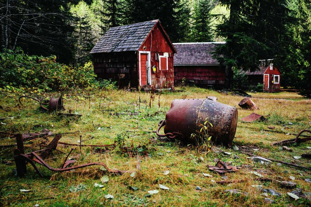 Rusted tools and other artifacts litter the ground within the defunct mining town of Monte Cristo, photographed Monday, October 27, 2014. The town can be accessed via a four mile hike through the forest, starting at the Barlow Pass Trailhead.