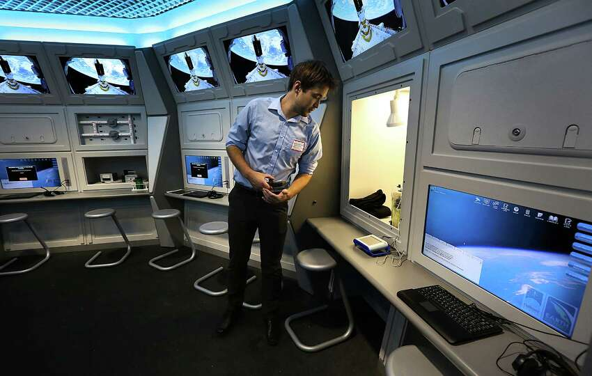 Brandon Bobinski, Education Manager of Challenger Center for Space Science, checks a display in the Challenger Learning Center. San Antonio College will open its new Scobee Planetarium, Observatory and Challenger Learning Center. Wednesday, Oct. 29, 2014.