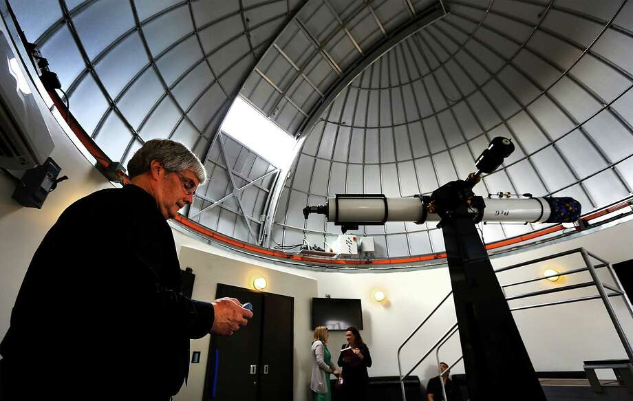 Bob Kelley, left, Planetarium Coordinator at the Scobee Education Center at San Antonio College, closes the cieling window of the remodeled Observatory in the Cheever Star Tower which is part of the new facility. San Antonio College will open its new Scobee Planetarium, Observatory and Challenger Learning Center this weekend. Wednesday, Oct. 29, 2014. Photo: BOB OWEN, San Antonio Express-News / © 2014 San Antonio Express-News