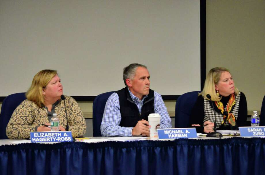 Board of Education chairman Betsy Hagerty-Ross, from left, Michael Harman and Sarah Zuro listen intently while Vicki Riccardo asks for an update on the special education audit. Photo: Megan Spicer / Darien News