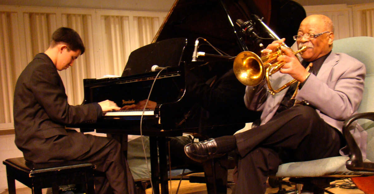 """Famed musician Clark Terry (right) mentors pianist Justin Kauflin in """"Keep On Keepin' On."""""""
