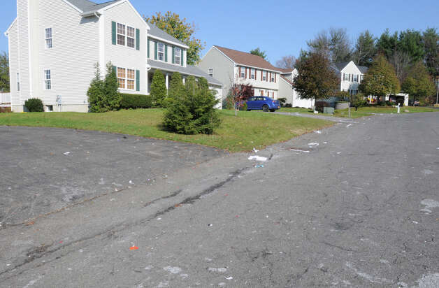 Streets were littered with toilet paper, eggs and shaving cream from the Halloween night incident on Clare Castle Dr. in Colonie, N.Y. Tuesday, Nov. 1, 2011. About 200 teenagers trashed the neighborhood and confronted police. (Lori Van Buren / Times Union) Photo: Lori Van Buren