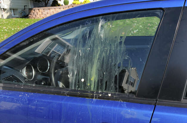 A car window parked in a driveway was egged from the Halloween night incident on Clare Castle Dr. in Colonie, N.Y. Tuesday, Nov. 1, 2011. About 200 teenagers trashed the neighborhood and confronted police. (Lori Van Buren / Times Union) Photo: Lori Van Buren