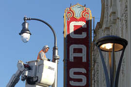 P,J. Singh works on new street lights out side the Castro The atre at the neigh bor hood's heart.