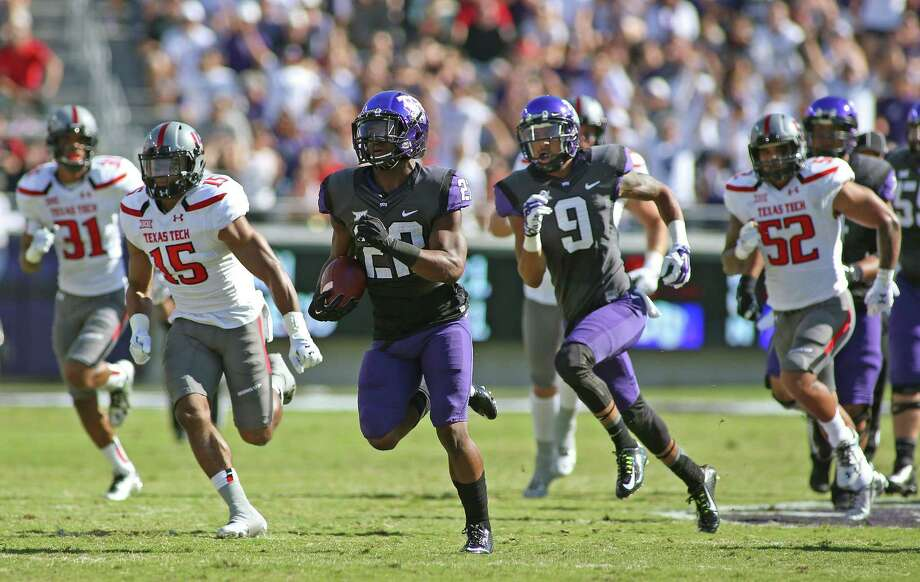 TCU running back Aaron Green (22) takes off on a 62-yard touchdown run in the first quarter against Texas Tech on Oct. 25. Photo: Paul Moseley / Paul Moseley / Fort Worth Star-Telegram / Fort Worth Star-Telegram