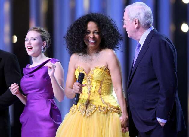 OSLO, NORWAY - DECEMBER 11:  Actress Scarlett Johansson, Diana Ross and Michael Caine dance on stage at the Nobel Peace Prize Concert 2008 at the Oslo Spektrum on December 11, 2008 in Oslo, Norway. The Norwegian Nobel Committee yesterday awarded the Nobel Peace Prize for 2008 to Martti Ahtisaari for his efforts to resolve international conflicts. Caine and Johansson hosted the gala event, which featured performances by Ross, operatic quartet Il Divo and Swedish singer-songwriter Robyn.  (Photo by Chris Jackson/Getty Images) *** Local Caption *** Scarlett Johansson;Diana Ross;Michael Caine Photo: Chris Jackson, Getty Images / 2008 Getty Images
