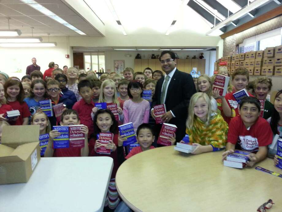 Rotary Club of Greenwich has continued its annual tradition of delivering dictionaries and thesauruses to all 11 Greenwich public school 3rd graders.  Pictured above is one of Rotary's newer board members, Anuj Patel, with some happy recipients of the books. Photo: Contributed Photo / Greenwich Time Contributed