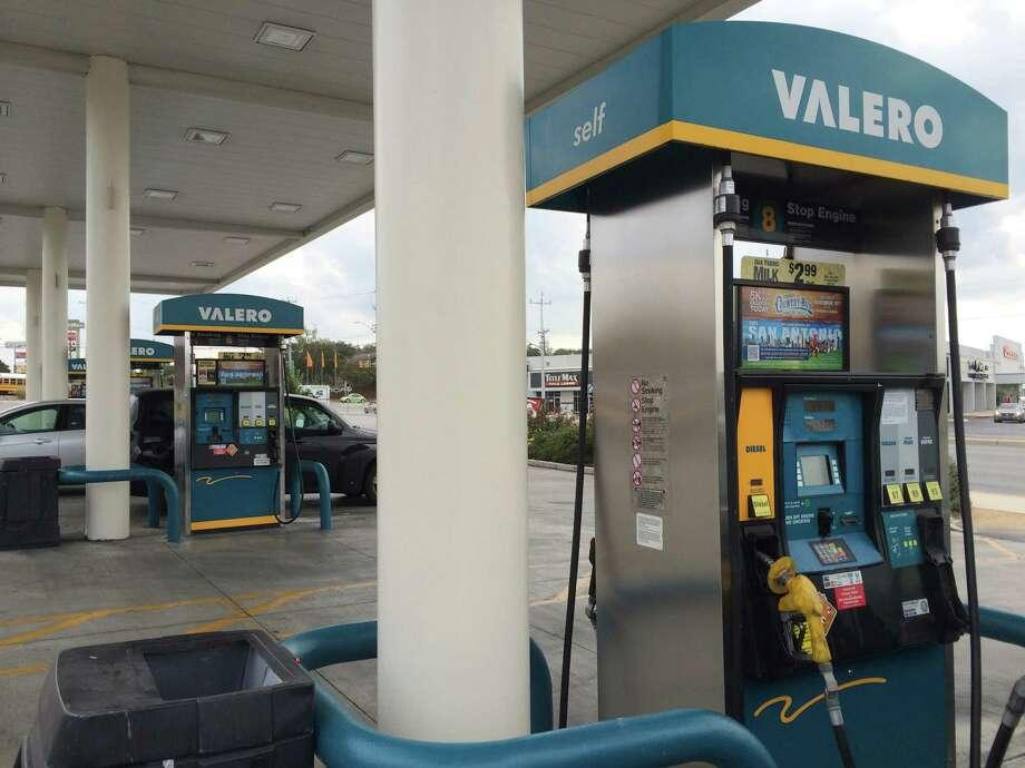 Customers visit the Valero CornerStore at U.S. 281 and Bitters Road in San Antonio on Wednesday, Oct. 29, 2014. Photo: Merrisa Brown/mySanAntonio.com