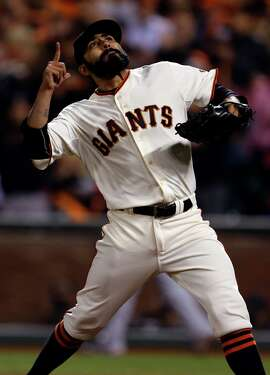 San Francisco Giants' Sergio Romo celebrates final out of 8th inning against Washington Nationals in Game 4 of National League Divisional Series at AT&T Park in San Francisco, Calif. on Tuesday, October 7, 2014.