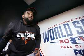 Giants' Pablo Sandoval heads out to batting practice, as the San Francisco Giants prepare to take on the Kansas City Royals in game seven of the World Series at Kauffman Stadium in Kansas City, Mo. on Tuesday Oct. 28, 2014.