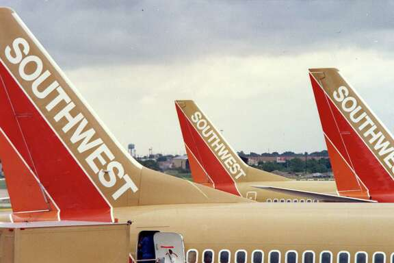 06/28/1989 - Hobby Airport has become Southwest Airlines' largest hub in the last year. Southwest airplane tails line up at their gates at Hobby Airport.
