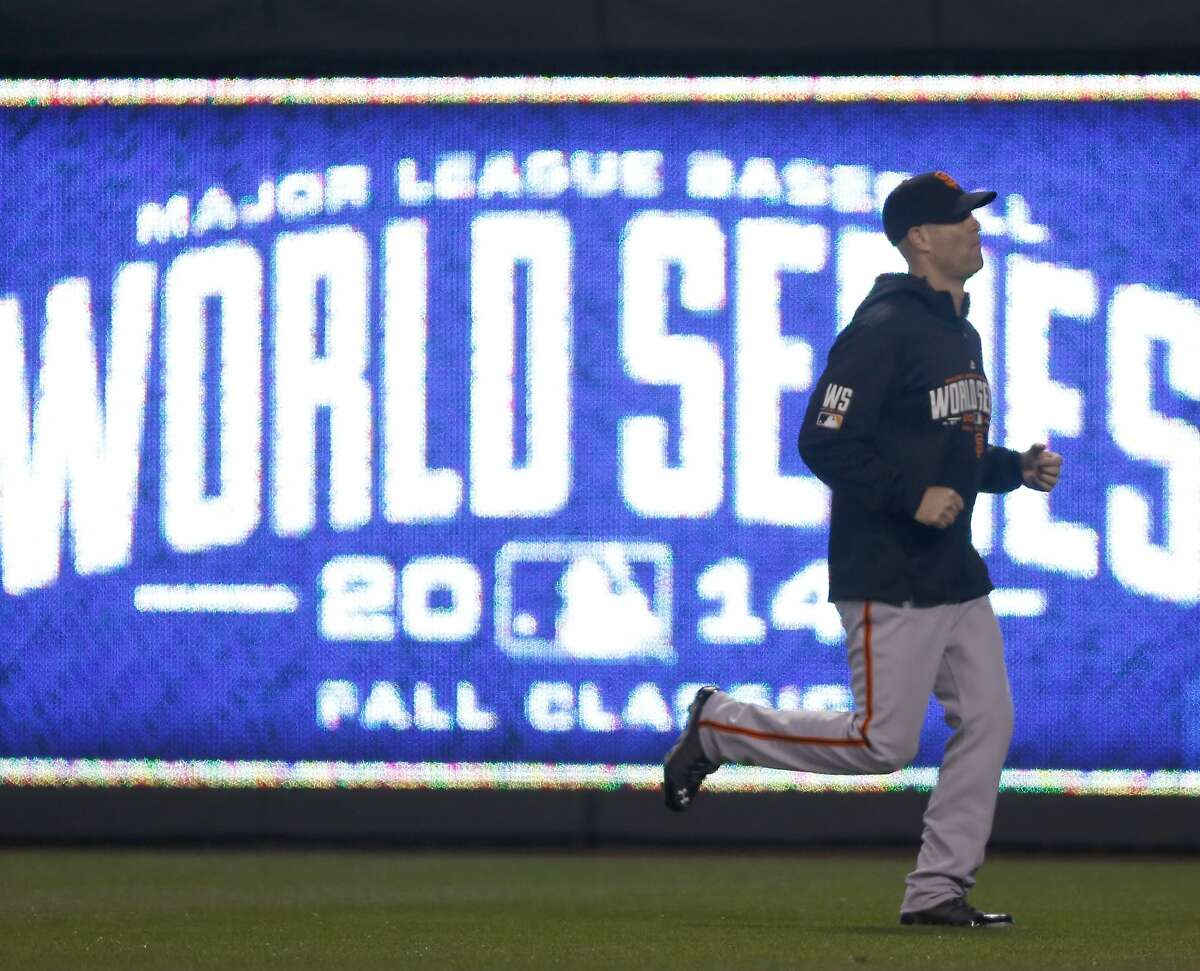 Giants Tim Hudson hits the field to warm up before Game 7 of the World Series at Kauffman Stadium on Wednesday, Oct. 29, 2014 in Kansas City, Mo.