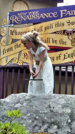 "Girl Power Emma Burick 10, attends the New York Renaissance Faire in Tuxedo N.Y. in August. She gave a good pull at the ""Sword in the Stone,"" says her dad, Michael Burick of Colonie. (Michael Burick)"