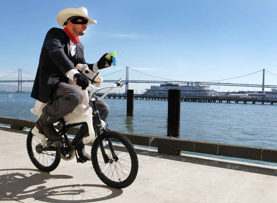 Dressed in his Lone Ranger Halloween costume, Autodesk employee Mike Warren rides a two-wheeled horse on Pier 9 in San Francisco, Calif. on Wednesday, Oct. 29, 2014. Photo: Paul Chinn / The Chronicle / ONLINE_YES