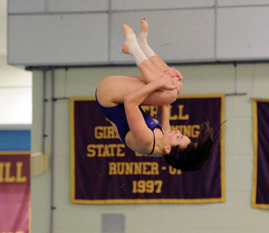 Rachel Burston of Westhill competes in the FCIAC girls high school Diving Championships at Westhill High School in Stamford, Conn., Wednesday, Oct. 29, 2014. Photo: Bob Luckey / Greenwich Time
