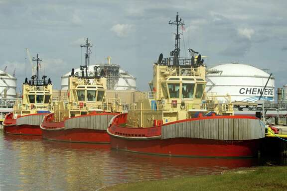 Custom tugboats designed to move specialized LNG tankers are docked at Cheniere Energy's Sabine Pass LNG facility in Cameron Parish, La. When it's complete, it will ship supercooled gas overseas.