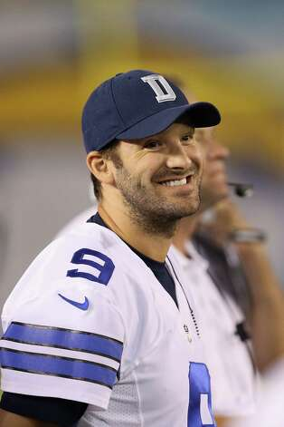 SAN DIEGO, CA - AUGUST 07:  Tony Romo #9 of the Dallas Cowboys looks on from the bench against the San Diego Chargers during a preseason game at Qualcomm Stadium on August 7, 2014 in San Diego, California.  (Photo by Stephen Dunn/Getty Images) ORG XMIT: 501328339 Photo: Stephen Dunn / 2014 Getty Images