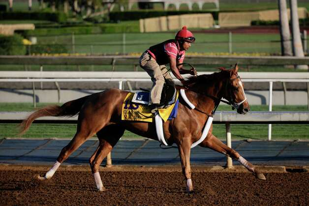 An exercise rider takes V.E. Day for a morning workout for the Breeders' Cup Classic horse race at Santa Anita Park Tuesday, Oct. 28, 2014, in Arcadia, Calif. (AP Photo/Jae C. Hong) ORG XMIT: CAJH105 Photo: Jae C. Hong / AP