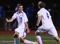 Fairfield Ludlowe's Mason Jennings (19) celebrates with teammate Lorin Tobey (4) after Tobey's goal in Fairfield Ludlowe's 1-0 win over Greenwich in the FCIAC high school boys soccer championship game at Norwalk High School in Norwalk, Conn. Wednesday, Oct. 29, 2014.