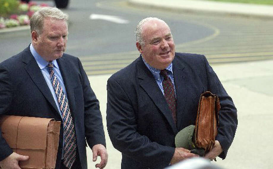 Michael Skakel, right, arrives at State Superior Court in Stamford, Conn., on Wednesday, July 30, 2014, with his attorney, Stephan Seeger, left. Photo: File Photo / Greenwich Time File Photo