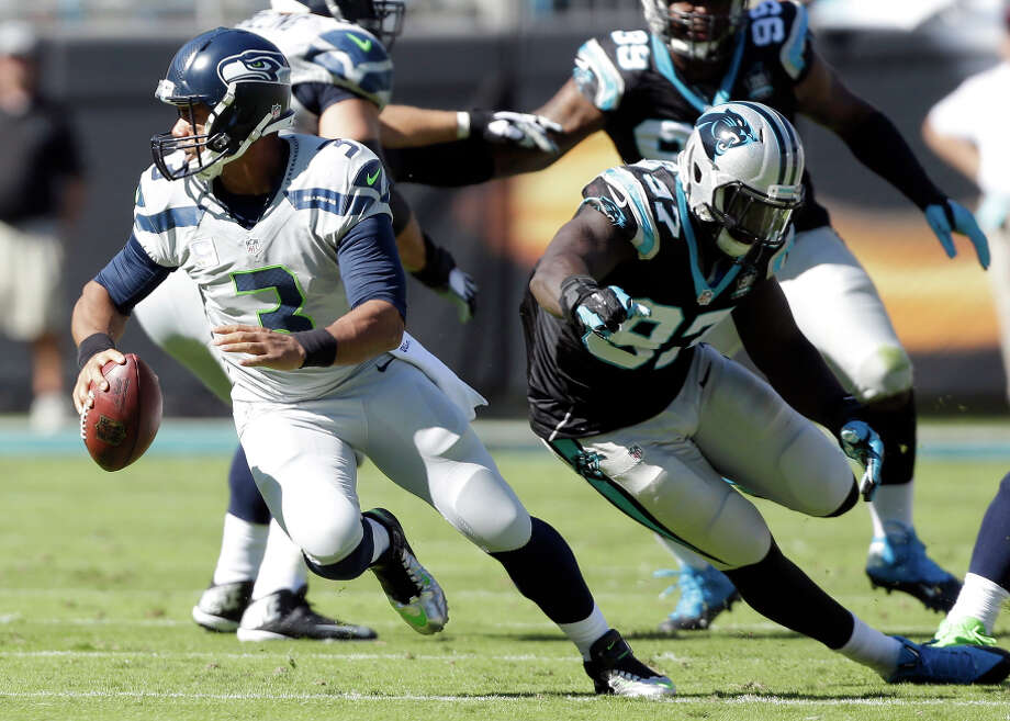 The Seattle Seahawks' offense has become increasingly centered on QB Russell Wilson's throwing and scrambling. Photo: Bob Leverone / Associated Press / FR170480 AP