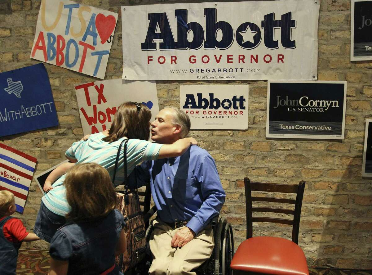 Texas Attorney General and GOP gubernatorial candidate Greg Abbott gets a hug from a supporter while he and Sen. John Cornyn campaign together at the Alamo Cafe on Wednesday. Local GOP leaders are concerned about voter turnout.