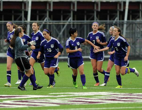 CCHS celebrates a score during their Class B girls' soccer semifinals against Hoosick Falls on Wednesday Oct. 29, 2014 in Troy, N.Y. (Michael P. Farrell/Times Union) Photo: Michael P. Farrell / 00029247A