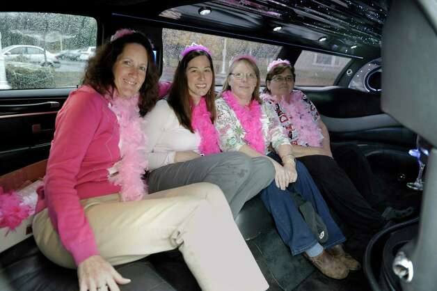 Evergreen Commons Nursing Home employees, Debbie Jakob, left, with human resources, Kari Neubauer, second from left, director of human resources, Donna Hopkins, third from left, R.N. and assistant director of nursing, and Deb DeLuke, R.N. unit manager, pose inside a limousine before heading to a local imaging center for mammography screening on Wednesday, Oct. 29, 2014, in East Greenbush, N.Y.  On Wednesday female employees at Evergreen Commons Nursing Home were able to take time off from work to get mammography screening.  (Paul Buckowski / Times Union) Photo: Paul Buckowski / 00029246A