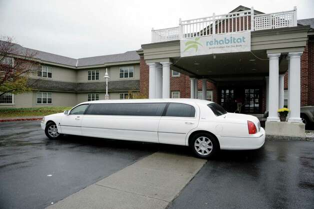 A limousine pulls away from Evergreen Commons Nursing Home with employees inside on Wednesday, Oct. 29, 2014, in East Greenbush, N.Y.  On Wednesday female employees at Evergreen Commons Nursing Home were able to take time off from work to get mammography screening.  The workers were taken to the imaging center in the limousine.  (Paul Buckowski / Times Union) Photo: Paul Buckowski / 00029246A