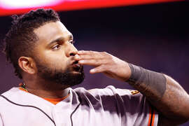 Giants Pablo Sandoval blows a kiss towards the crowd at the end of the top of the eighth inning during Game 7 of the World Series at Kauffman Stadium on Wednesday, Oct. 29, 2014 in Kansas City, Mo.