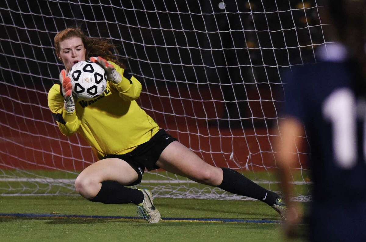 Fairfield Warde goalie Richelle Barone makes a save in Fairfield Warde and Staples' 1-1 double overtime tie in the FCIAC high school girls soccer championship game at Norwalk High School in Norwalk, Conn. Wednesday, Oct. 29, 2014.