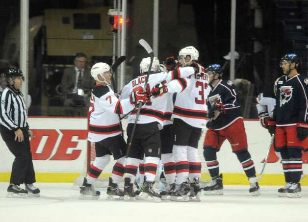 The Devils celebrate following a goal during their hockey game against Springfield at the Times Union Center on Wednesday Oct. 29, 2014 in Albany, N.Y. (Michael P. Farrell/Times Union) Photo: Michael P. Farrell / 00029212A