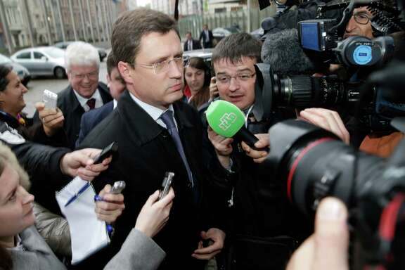 Russia's Energy Minister Alexander Novak makes his way towards the European Commission headquarters in Brussels, Wednesday, Oct. 29, 2014. The European Union's energy chief is hoping Wednesday's negotiations between Ukraine and Russia will assure the breakthrough needed to guarantee that Russian gas will continue to flow to Ukraine and, by extension, parts of the EU this winter. (AP Photo/Yves Logghe)