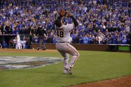Then-Giants third baseman Pablo Sandoval prepares to catch a foul pop, the final out of the 2014 World Series.