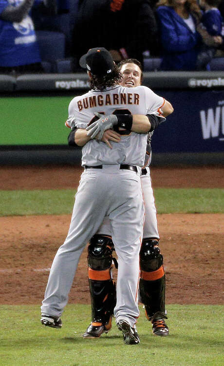 Giants Madison Bumgarner and Buster Posey celebrate after the Giants make the final out of the game, winning game seven of the World Series against the Kansas City Royals at Kauffman Stadium in Kansas City, Missouri, on Wednesday Oct. 29, 2014. Photo: Carlos Avila Gonzalez / The Chronicle / ONLINE_YES