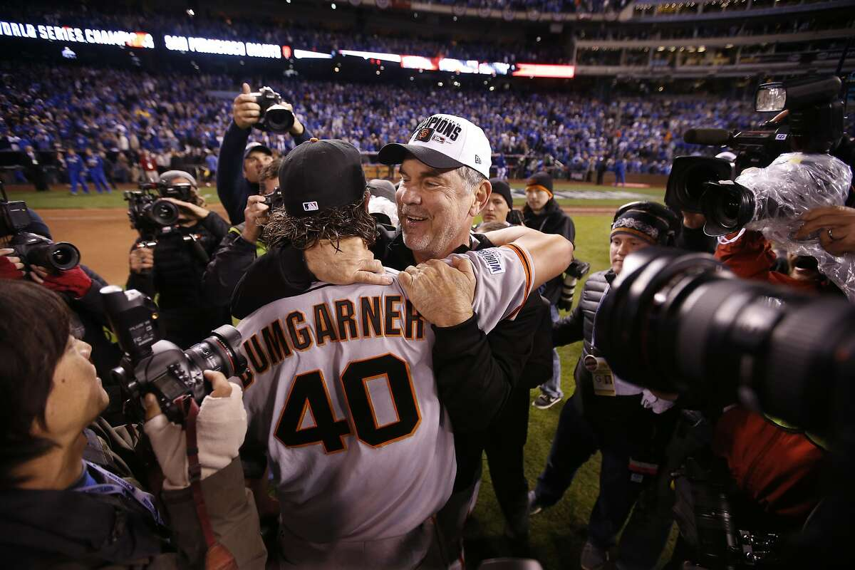 Giants Madison Bumgarner and Giants manager Bruce Bochy embrace after the Giants defeated the Royals 3 to 2 to win the World Series in Game 7 of the World Series at Kauffman Stadium on Wednesday, Oct. 29, 2014 in Kansas City, Mo.