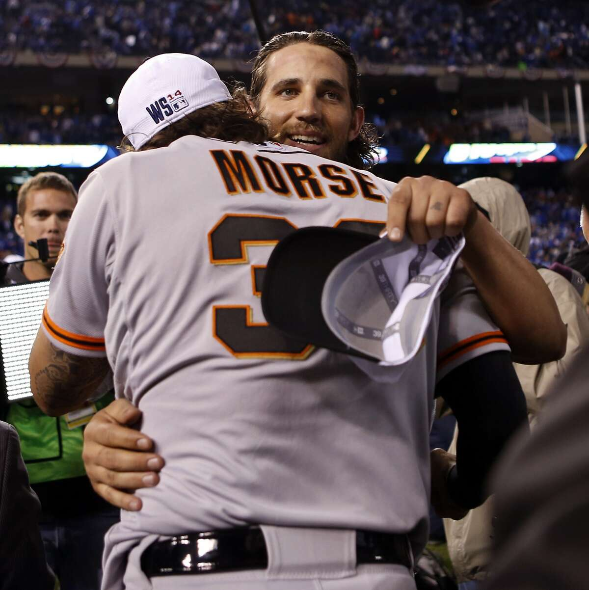 San Francisco Giants' Madison Bumgarner and Michael Morse hug after Game 7 of the World Series at Kauffman Stadium on Wednesday, Oct. 29, 2014 in Kansas City, Mo.