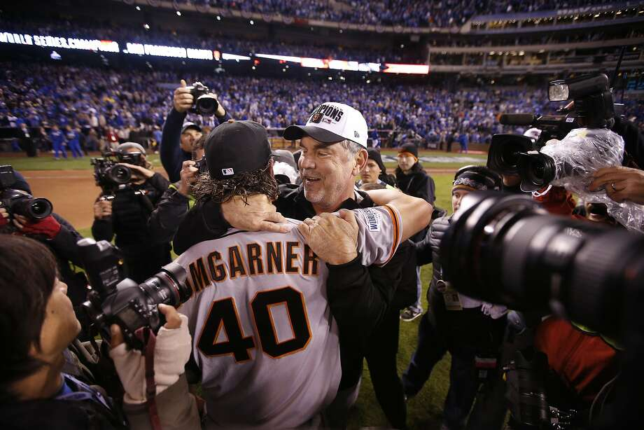 Giants Madison Bumgarner and Giants manager Bruce Bochy embrace after the Giants defeated the Royals 3 to 2 to win the World Series in Game 7 of the World Series at Kauffman Stadium on Wednesday, Oct. 29, 2014 in Kansas City, Mo. Photo: Michael Macor, The Chronicle