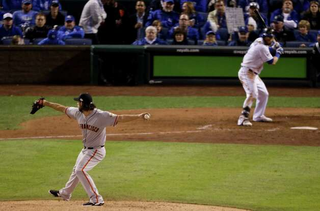 San Francisco Giants starting pitcher Madison Bumgarner throws against the Kansas City Royals during the sixth inning of Game 7 of baseball's World Series Wednesday, Oct. 29, 2014, in Kansas City, Mo. (AP Photo/Charlie Riedel)  ORG XMIT: WS539 Photo: Charlie Riedel / AP