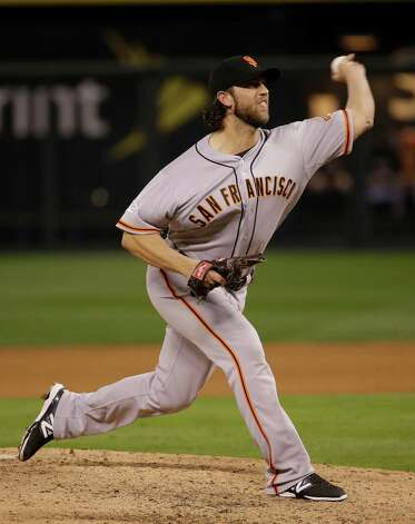 San Francisco Giants pitcher Madison Bumgarner throws during the fifth inning of Game 7 of baseball's World Series against the Kansas City Royals Wednesday, Oct. 29, 2014, in Kansas City, Mo. (AP Photo/Matt Slocum)  ORG XMIT: WS154 Photo: Matt Slocum / AP