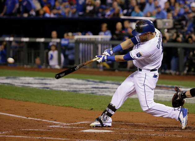Kansas City Royals Alex Gordon hits an RBI double during the second inning of Game 7 of baseball's World Series against the San Francisco Giants Wednesday, Oct. 29, 2014, in Kansas City, Mo. (AP Photo/Matt Slocum)  ORG XMIT: WS123 Photo: Matt Slocum / AP