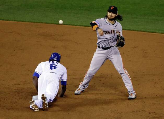 Kansas City Royals' Lorenzo Cain (6) is out at second as San Francisco Giants' Brandon Crawford turns a double play on a ball hit by Eric Hosmer during the third inning of Game 7 of baseball's World Series Wednesday, Oct. 29, 2014, in Kansas City, Mo. (AP Photo/Jeff Roberson)  ORG XMIT: WS332 Photo: Jeff Roberson / AP
