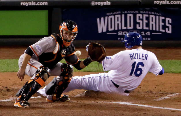 Kansas City Royals' Billy Butler scores past San Francisco Giants catcher Buster Posey on a hit by Alex Gordon during the second inning of Game 7 of baseball's World Series Wednesday, Oct. 29, 2014, in Kansas City, Mo. (AP Photo/Charlie Riedel)  ORG XMIT: WS523 Photo: Charlie Riedel / AP